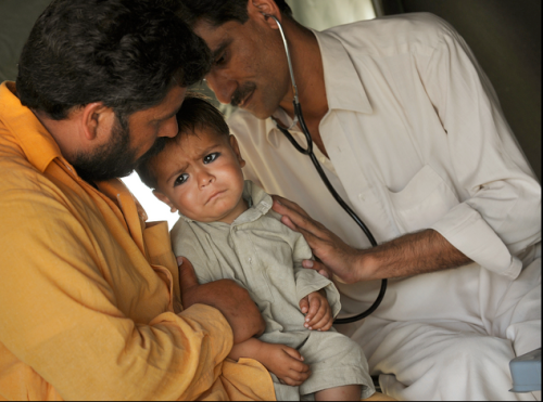 Image Credit: Wash Po, Child Being Checked in an IDP Camp in Mardan